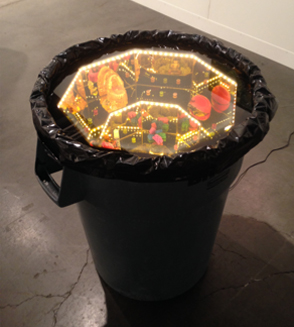 Ajay Kurian, Hive (Want), trash can, plexi, fake pearls, rose lenses, wood, custom M&Ms, reindeer moss, LED lights, copper wire, plastic.